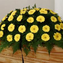Onoranze Funebri Ripamonti & Berna - Bara con fiori gialli